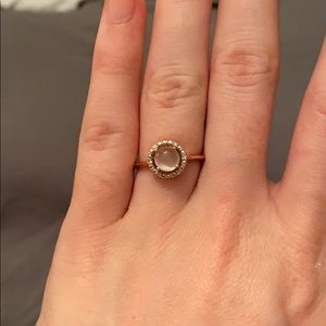 Moonstone ring. Side diamonds in rose gold band.